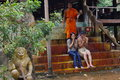 Young cambodian couple and a buddhist monk Royalty Free Stock Photo
