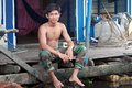 Young Cambodian Man in Tonle Sap lake,Floating Village, Siem Reap Cambodia