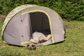 Young camper sleeping man in a tent Royalty Free Stock Image