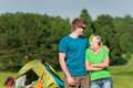 Young camping couple hugging in summer countryside Royalty Free Stock Images