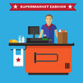 Young cashier man standing in supermarket Royalty Free Stock Photo