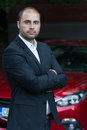 Young casual businessman with red car Royalty Free Stock Photo