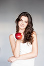 Young casual caucasian girl with red apple Royalty Free Stock Photo