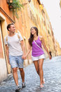 Young casual couple holding hands walking in rome italy europe multiracial in love having fun laughing together asian woman Stock Image