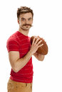 Young casual football player man dressed in street clothes holds a ready to throw a pass isolated on white background Stock Photos