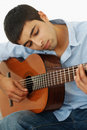 Young casual guy playing a guitar isolated Stock Image