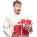 Young casual man hoding christmas gift caucasian holding red isolated on white background Stock Photos
