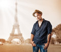 Young casual man isolated on white background fashion in dark blue shirt and jeans posing in paris france Stock Photos