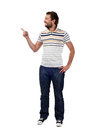 Young casual man pointing. Isolated Stock Images