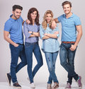 Young casual men leaning on women shoulders and smile Royalty Free Stock Photo