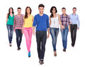 Young casual people walking forward Royalty Free Stock Photography
