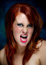 Young casual red haired female portrait pulling a face Stock Photos