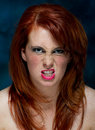 Young casual red haired female portrait pulling a face Royalty Free Stock Photography
