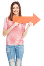 Young casual woman with an arrow showing a direction a red Royalty Free Stock Photography