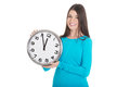 Young casual woman is holding a clock isolated on white Royalty Free Stock Photos