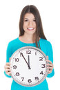 Young casual woman is holding a clock isolated on white Stock Images