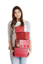 Young casual woman holding stock of presents isolated on white Stock Photos