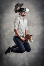 Young caucasian adult man enjoy experiencing immersive Virtual Reality cowboy game simulation.VR portrait concept with