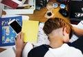 Young caucasian boy fell a sleep while doing homework