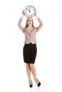 Young caucasian business woman holding clock. Royalty Free Stock Photo