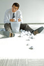 Young caucasian businessman seeking document in trash bin Royalty Free Stock Photos