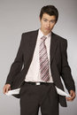 Young caucasian businessman showing his empty pockets Royalty Free Stock Photo