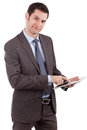 Young caucasian businessman using a tablet pc Stock Images