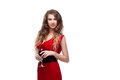 Young caucasian elegant woman red long dress holding wineglass isolated white Royalty Free Stock Image