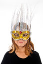 Young caucasian female child wearing fancy masquerade mask Royalty Free Stock Photography