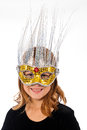 Young caucasian female child wearing fancy masquerade mask smiling happily Stock Image