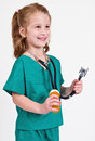 Young caucasian girl dressed up playing doctor wearing green surgery outfit stethoscope holding pill bottle Stock Images