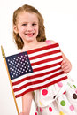 Young caucasian girl polka dot dress holding american flag Stock Images