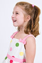 Young caucasian girl polka dot dress looking up to left Stock Photos