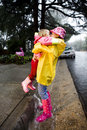 Young caucasian girls hugging in the rain Stock Image