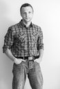 Young caucasian man in checkered shirt and jeans black and white portrait Royalty Free Stock Photos