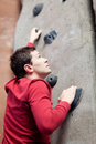 Young caucasian man rock climbing indoors Stock Image