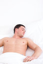 Young caucasian man sleeping in his bed at home half naked domestic atmosphere Stock Photography