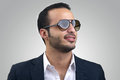 Young caucasian man wearing sunglasses posing Royalty Free Stock Image