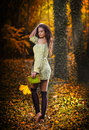 Young caucasian sensual woman in a romantic autumn scenery fall lady fashion portrait of a beautiful young woman in forest Royalty Free Stock Photography
