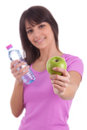 Young caucasian woman holding a bottle of water and an apple Stock Photography