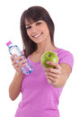 Young caucasian woman holding a bottle of water and an apple Royalty Free Stock Photo