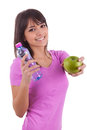 Young caucasian woman holding a bottle of water and an apple Stock Photo