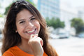 Young caucasian woman in a orange shirt in the city Royalty Free Stock Photo