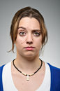 Young caucasian woman raised eyebrow portrait a doubtful raising her eyebrows Stock Photos