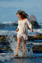 Young caucasian woman refreshing on the beach in summer evening Stock Photos