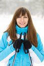 Young caucasian woman skiing at winter outdoor pretty smiling girl standing with ski Stock Image