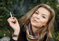 Young caucasian woman smokes a cigarette problems of Royalty Free Stock Photography