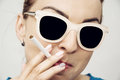 Young caucasian woman smoking cigarette, bad habit Royalty Free Stock Photo