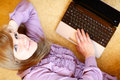 Young caucasian woman using laptop netbook at home top view shot Stock Photo