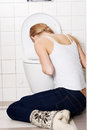 Young caucasian woman is vomiting in the bathroom bulimia sick concept Royalty Free Stock Photos